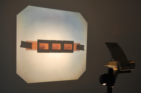 Elaine Fisher_Suspended load_35mm photographic slides_film strip_tape_overhead projector_dimensions variable (projector w38cm x d40cm x h70cm)_2014_£550